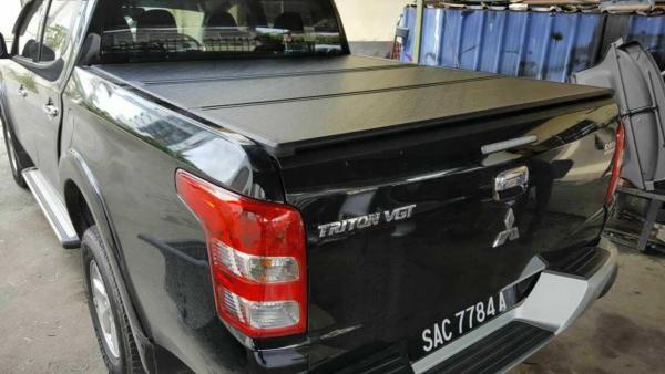 Купить Жесткая трехсекционная крышка кузова для Mitsubishi L200